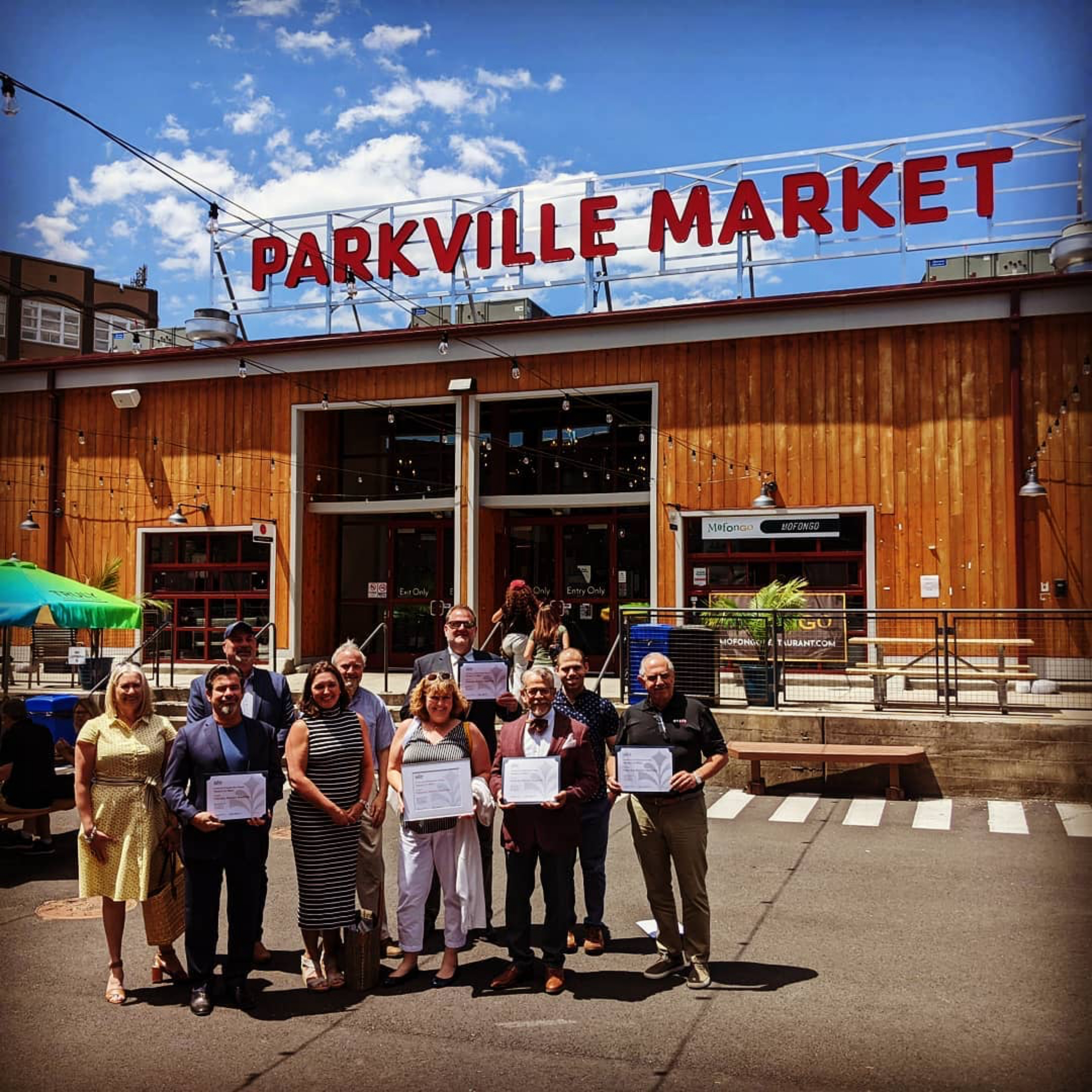 Twenty-five years ago, longtime Parkville resident Carlos Mouta bought several buildings in this former industrial neighborhood now listed on the National Register of Historic Places. When a FastTrack bus terminal opened nearby, Parkville became more accessible, sparking new opportunities for redevelopment, and @parkvillemarket was born. Today, we had the chance to join the team to present them with their CT Preservation Award of Merit- and have lunch!  The market campus consists of three buildings built in 1914 and 1921 for a lumber company. The central building, a 200-foot-long warehouse, is the first to be redeveloped has been transformed into a vibrant food hall, offering space for 18 vendors as well as dining areas, meeting rooms, and event space. Sustainable design and cooperation with local nonprofits played important roles in the conversion. Although the market opened in the middle of the pandemic, all segments of the community have happily come to eat, drink, work on their laptops, play in the courtyard, and meet in the meeting rooms. By highlighting Hartford's diverse population and its food culture, Parkville Market has been embraced by its neighbors and not seen as a foothold for gentrification.   Project team: Parkville Market, LLC, BETA Group, Inc., @lifecaredesign, The ArtFitters, LLC, Aztech Engineers  Another thanks to the generous sponsors of our awards ceremony: @crosskeyarch , JMKA Architects, @gulickco.renovations and @patriquinarch and thanks to Board member @deb_frontdoorproject for joining us!